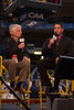 Dr Alan Merten, President of George Mason University, speaks with Mike Corey from Comcast Sportsnet during the 2012 CAA Tournament George Mason beats Georgia State 61-59 at the Richmond Collosium