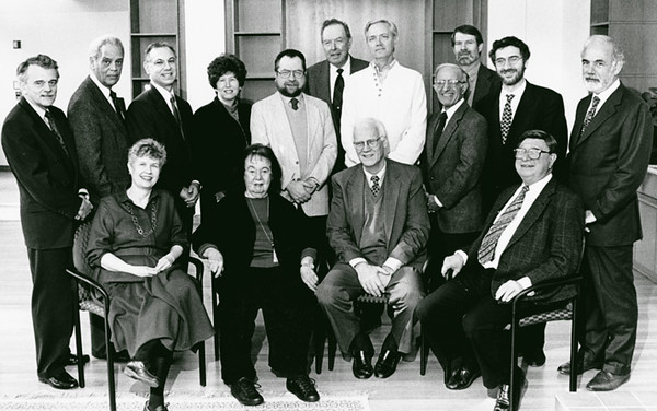 President Johnson poses with some of the Robinsons. Back, David Potter (former provost), Roger Wilkins, Paul D'Andrea, Lenore Weitzman, Jean-Paul Dumont, Johnson, Hugh Heclo, Shaul Bakhash, Robert Hazen, Daniele Struppa (former dean of the College of Arts and Sciences), and Egon Verheyen. Front, Iris Knell, Thelma Lavine, John Paden, and Harold Morowitz. Photo by George Mason University