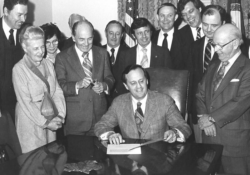 George W. Johnson (far left) joins Gov. Dalton signing legislation for the George Mason University Law School in 1978.