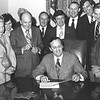 George W. Johnson (far left) joins Gov. Dalton signing legislation for the George Mason University Law School in 1978.