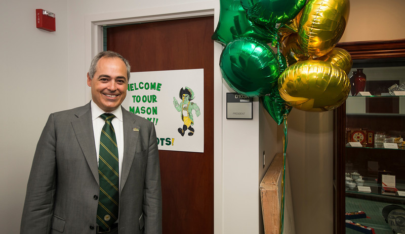 President Ángel Cabrera is welcomed to his office at Mason Hall on Fairfax Campus. Photo by Alexis Glenn/Creative Services/George Mason University