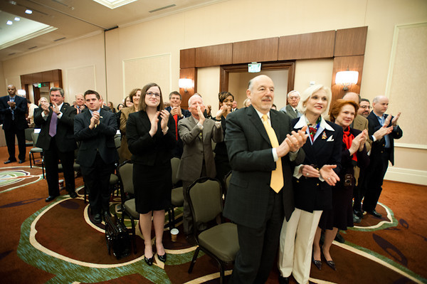 111215508s - The audience at the press conference announcing his appointment gave Dr. Ángel Cabrera, Mason president-elect, a standing ovation when he was introduced on Dec.15, 2011, at the Mason Inn. Photo by Alexis Glenn/Creative Services/George Mason University.