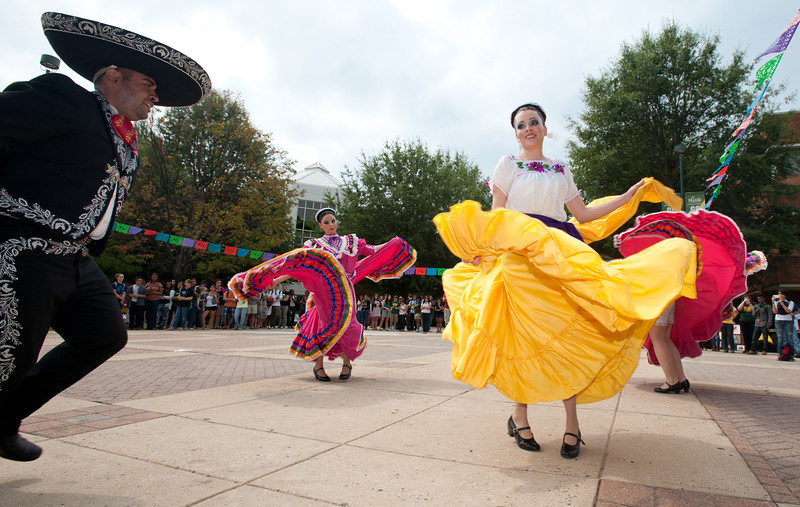 The Office of Diversity Programs and Services kicks off Hispanic Heritage Month with Latin food and traditional dancing at the North Plaza of the Johnson Center, Fairfax Campus. Photo by Alexis Glenn