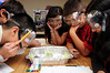 Students in a Hutchinson Middle School STEM class work on a project under the supervision of Mason graduate student Prabal Saxena and Fairfax County School teacher Christina Fentress. Photo by Evan Cantwell