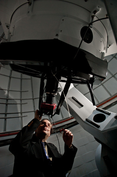 Portrait of Dr. Harold Geller, Observatory Director, College of Science, School of Physics, Astronomy and Computational Science using the Observatory Telescope. Photo by Alexis Glenn