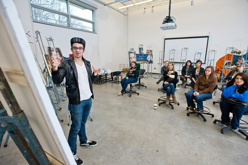 Students discuss their artwork at a painting class final critique at the Art and Design building at Fairfax Campus. Photo by Alexis Glenn