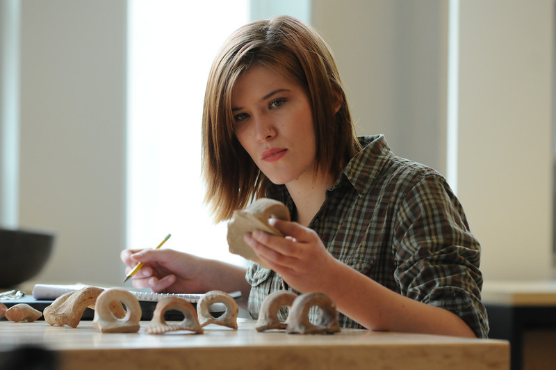 A Mason Honors student catalogues artifacts. Photo by Evan Cantwell