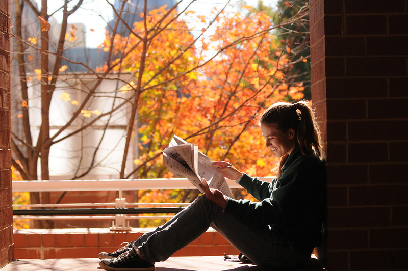 A Mason student reads a newspaper on Fairfax Campus. Photo by Evan Cantwell