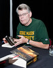Author Stephen King signs books for fans at the Center for the Arts Concert Hall, Fairfax Campus during the 2011 Fall for the Book festival. The annual festival connects readers and authors at all levels, offering book lovers the chance to meet and greet their favorite writers and hear behind-the-scenes stories of writing and publishing. Photo by Alexis Glenn