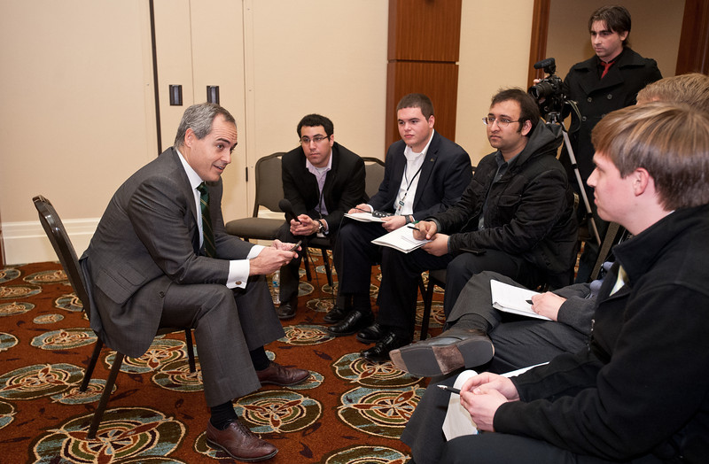 Dr. Angel Cabrera, President-Elect of George Mason University, speaks and tweets with Mason student media after he was announced as the University's next president on December 15, 2011 at the Mason Inn at Fairfax Campus. Dr. Cabrera tweeted with the student media during their discussion. He will take over as University President in July 2012, coming from the Thunderbird School of Global Management in Arizona. Photo by Alexis Glenn