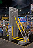 Concrete/masonry construction: Adjust-It wall bracing to support a free-standing masonry wall against wind forces. Bracing shown here uses diagonal rectangular steel tubing in compression on both sides of the wall. World of Concrete/Masonry, Las Vegas, Nevada January 2006