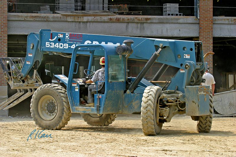 Brick construction: Gradall 534D9-45 rear pivot steering telescoping boom rough terrain material handler fitted as forklift for delivery of masonry construction materials. YMCA, Ann Arbor, 2004.