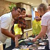 Fr. Sugi helps visitors