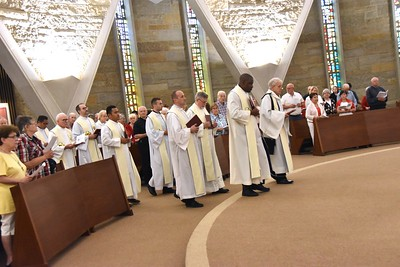 The concelebrants process into the chapel