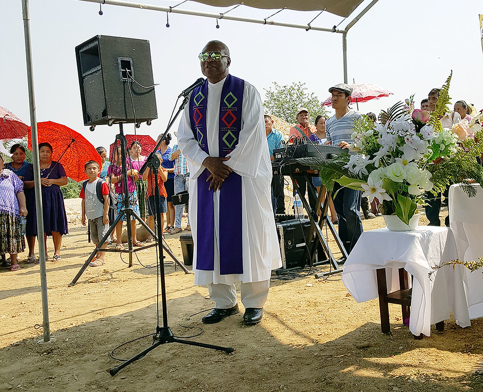 Father Callistus Cayetano welcomed arrivals in four languages