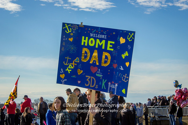 Family members with signs.