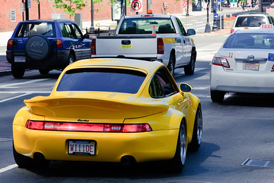 Just a cool and brightly colored Porsche traveling past Faneuil Hall.
