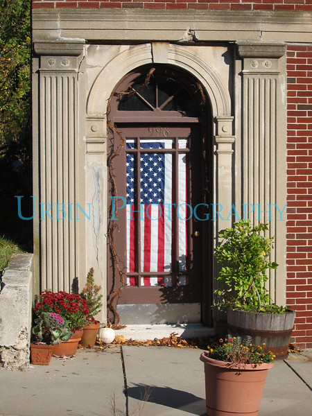 A doorway with a flag in Needham, MA.