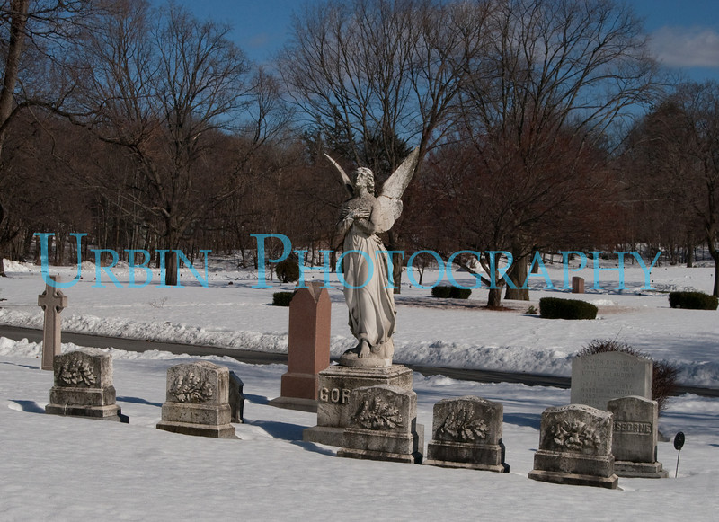 The Guardian Angel for a row of headstones.