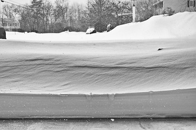 Raised the garage door, oh boy we have some snow blowing to do. 9:29am still snowing!