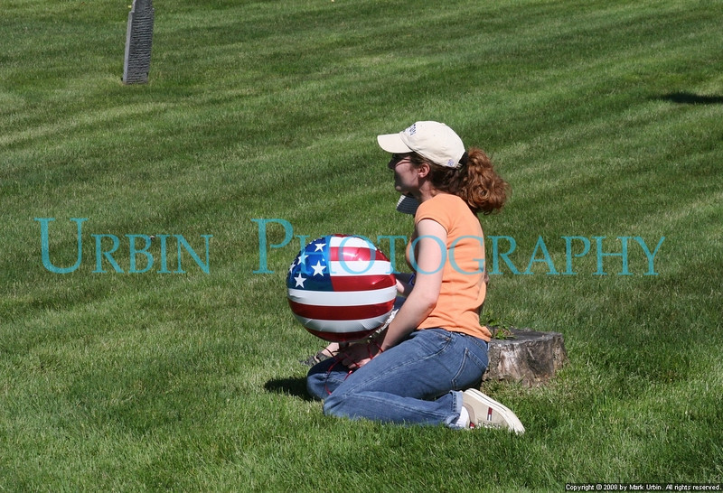 A woman and her small child watching part of the Memorial Day ceremony at Midland Cemetary.