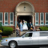 The bride in the door way of St. Luke's Church in Westborough, MA.