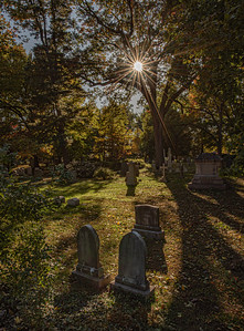 Mt. Auburn tombstone with sun starburst