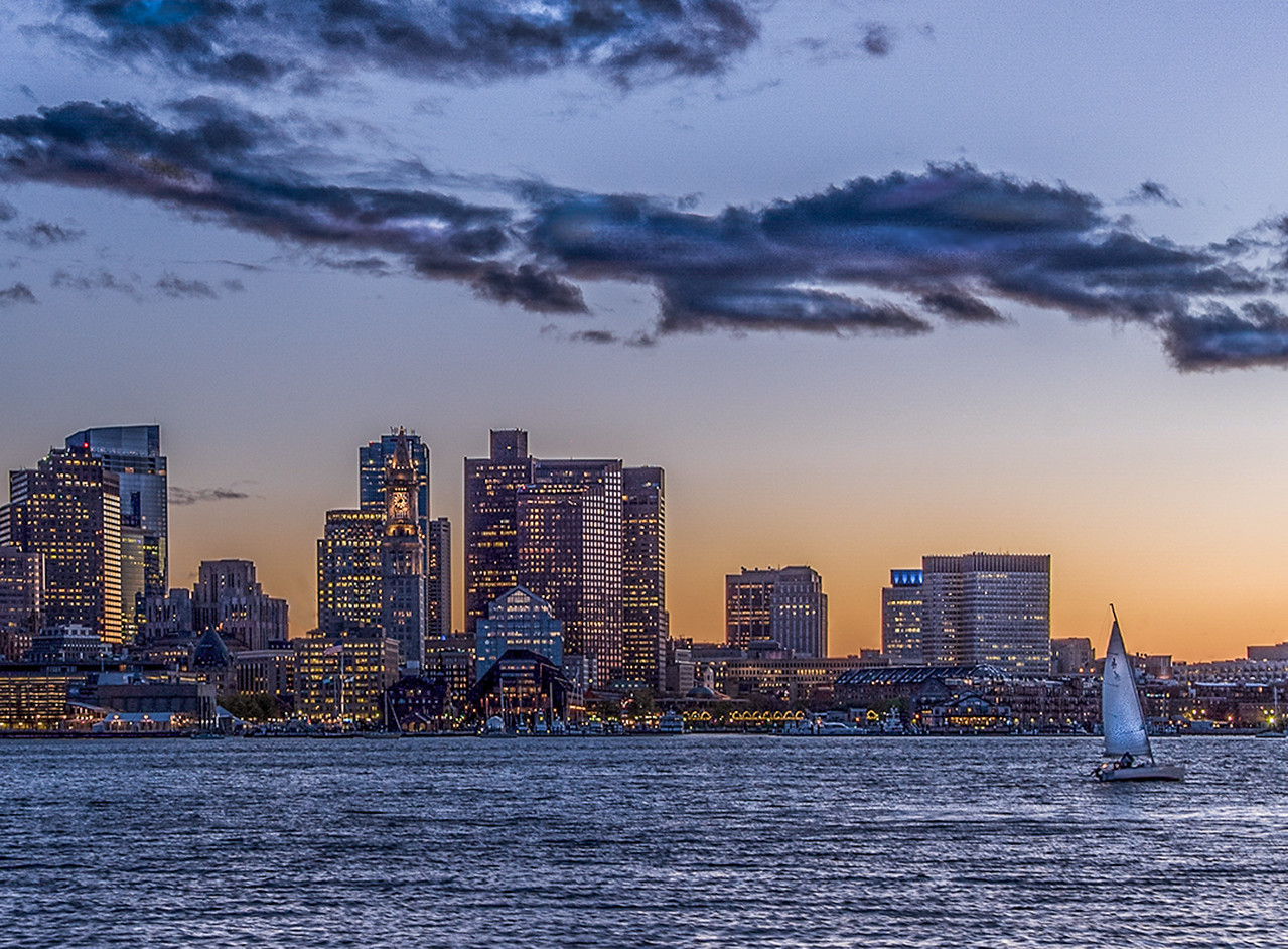 Boston Skyline Blue Hour lights with sailboat