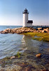 Six and a half acres of land was purchased for $140 on Wigwam Point in 1800. A 32 foot wooden lighthouse with a fixed light and a two room Keepers dwelling were constructed in 1801.