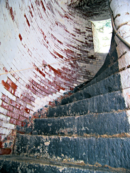 **The stairway in the lighthouse tower**  The characteristic of the taller 'Pa' lighthouse was changed to a flashing red and white sequence.