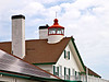 A 5th Order fixed Fresnel lens was installed in the lantern room.  It exhibited a fixed white light visible for 8 miles.