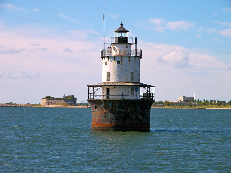 A 35 foot diameter iron caisson was constructed and towed out to Butler Flats and sunk into the muddy bottom.  The caisson was filled with stones to anchor it in place and a platform to support the lighthouse was built atop the cylinder.