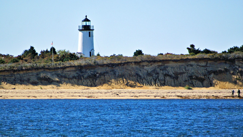Four acres of land were purchased on the northeast corner of Chappaquiddick for a lighthouse reservation.  A local contractor, Duncan McBean, was hired to construct the first Cape Poge Lighthouse.  The tower was a 35-foot octagonal shingled wooden tower with a diameter of 19 feet at the base and seven feet at the top.  In addition to the lighthouse, a small two room Keepers dwelling was also erected near the tower.