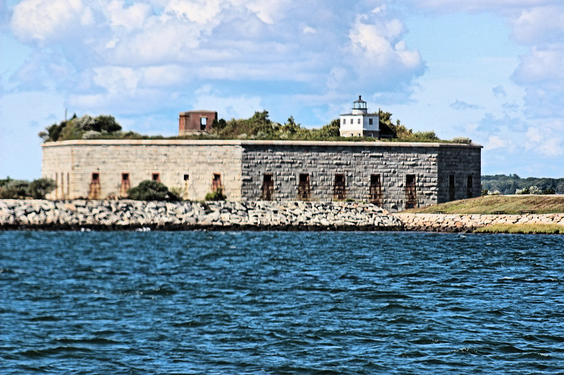In 1857 the federal government purchased a farm at Clark's Point in order to build granite 3 tier fort which would later be named Fort Taber after a Mayor of New Bedford.  By 1869 the walls of the fort reached a height that obscured the light from the lighthouse lantern.  It was decided to move the light from the tower to a wooden lighthouse built on top of the fort in June 1869.
