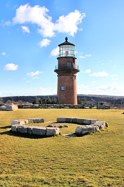 The residents of Aquinnah moved quickly and voted to obtain ownership of the lighthouse from the Coast Guard.  They prepared a plan to move the 400 ton structure and raised funds for the $3 million dollar project.  Ownership of the tower was awarded to Aquinnah in February 2015.  International Chimney Corporation, who had previously moved the Sankaty Head, Highland and Nauset Lighthouses, planned and executed the move in 3 days during May 2015.  The lighthouse was moved onto a concrete pad 129 feet from its original location, marked by the rocks shown in this picture.