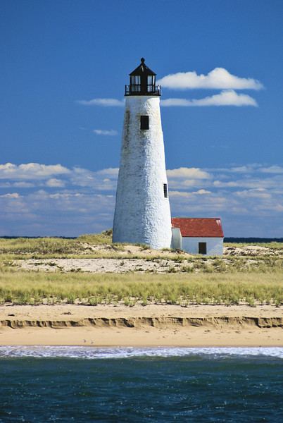 A concrete and plastic replica of the 1818 tower was built 300 feet from the original location. An important addition were solar panels built into the wall of the lighthouse to provide power. On September 7, 1986 Senator Kennedy christened the new tower with a bottle of champagne.