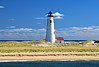 Located on a thin spit of beach where the currents of the Atlantic Ocean and Nantucket Sound meet, the Great Point Lighthouse on Nantucket was first built in 1784. The original tower was made of wood. Since there was no dwelling built for the Keeper, he had to travel 7 miles over the dunes to the lighthouse each day.