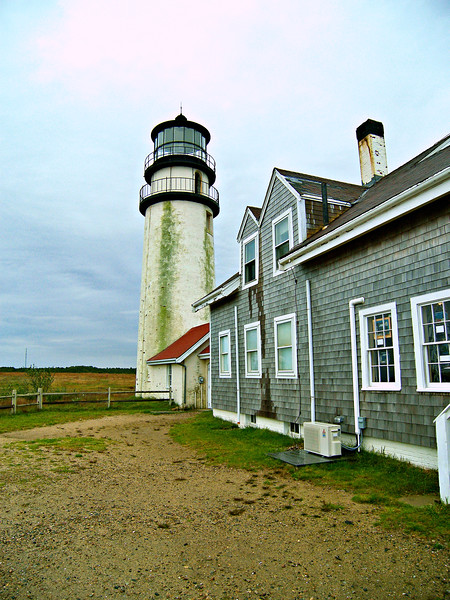 In 1797 a 45 foot wooden octagonal tower was built upon a stone foundation 500 feet back from the cliffs on the Truro beachfront.