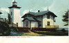 A turn of the century postcard view of the lighthouse showing the dwelling prior to its additions.
