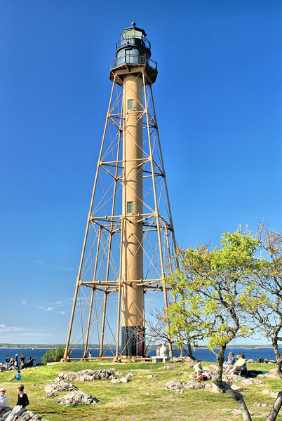 In 1960 the Marblehead Lighthouse was automated and its Fresnel lens was replaced with a modern optic.  The tower was sandblasted and repainted in 1980 and again in 1993.  The tower is looked after by the Town of Marblehead while the Coast Guard maintains the navigational aid.  The lighthouse in Chandler Hovey Park serves as a gathering place for Marblehead residents who string lights on lighthouse for the 4th of July and Christmas.