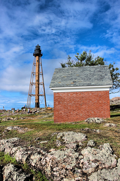 In July 1883 an auxiliary light was constructed near the lighthouse.  This required the Keeper to light a lamp and hoist it to the top of a 100 foot pole.  It was difficult to keep the lantern lit but this method was used for the next 12 years.