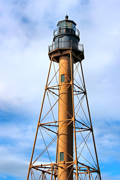 A 6th Order Fresnel lens replaced the oil lamps in the lantern in 1857.  During the 1860's the land surrounding the lighthouse was subdivided and eventually summer homes were constructed on Marblehead Neck.  By the 1880's the tiny lighthouse was obscured by opulent homes along the coast.