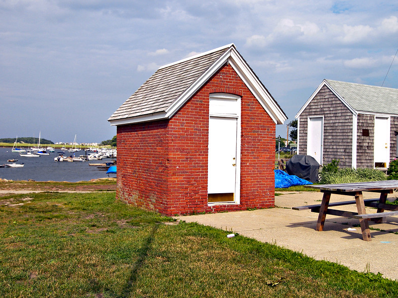 A view of the Minots Ledge Lighthouse Oil House on Government Island.