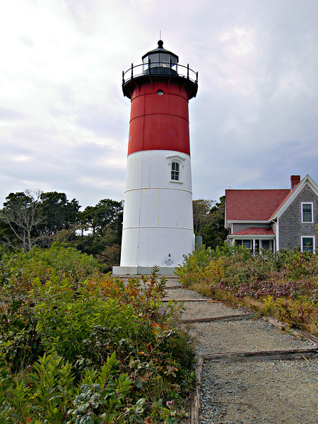 The decision was made to disassemble the North Tower at Chatham, barge it north to Eastham and reassemble the structure on the bluff at Nauset Beach.  The iron tower had been in service at Chatham since 1877.