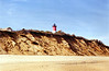 **The Lighthouse before the move** Over the years erosion continued to eat away at the Nauset Beach bluff until it once again threatened the Nauset Light.  In anticipation of the towers demise, the Coast Guard in 1993 proposed decommissioning the lighthouse.