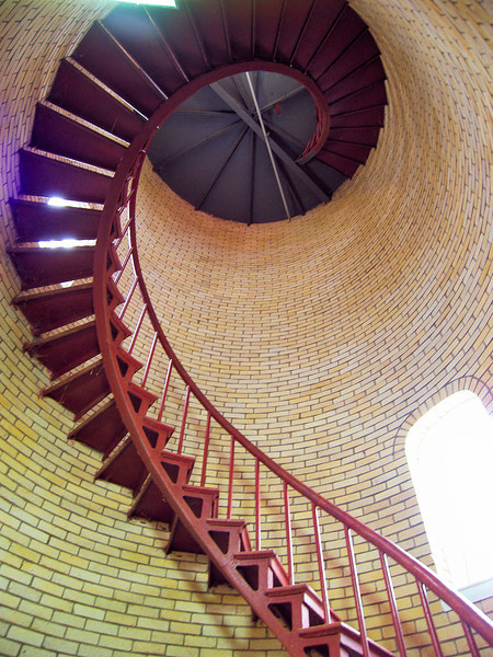 A six foot thick octagonal concrete foundation was laid 200 feet from the bluff edge.  The lighthouse was reassembled, the interior was lined with two courses of brick and a 4th Order Fresnel Barbier & Fenester lens from the old tower was placed in the lantern.
