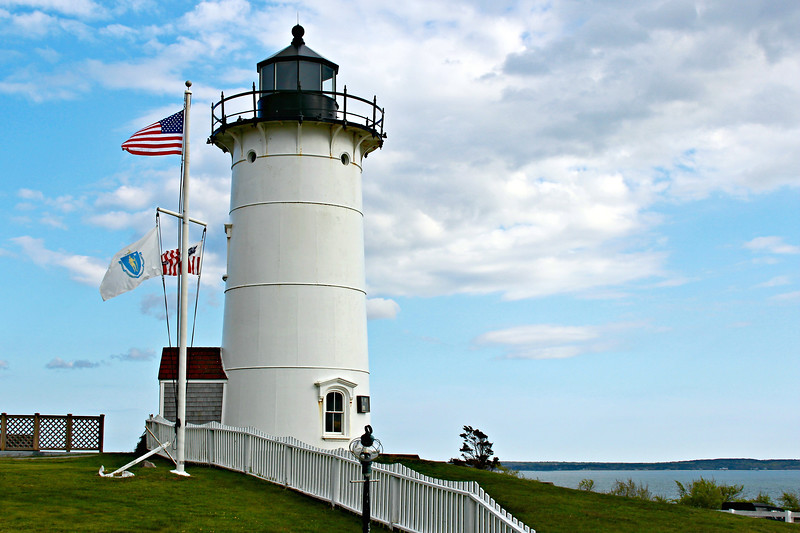The lantern's service gallery was adorned with small brass lighthouses on each of the balusters, similar to Maine's Nubble Light and Lubec Channel Light.