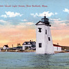 An old postcard view of the Palmer Island Lighthouse Station prior to the 1938 hurricane showing the Keepers dwelling, the old fog bell tower, oil house, covered walkway and the new fog bell tower attached to the lighthouse.  All of the buildings were swept away by the hurricane.