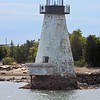 The Palmer Island Light ranged with a rear light set up during the 1890's first on the Fairhaven Bridge and later the Watsutta Mill to help guide ships past a shoal area in the river known as the Butler Flats.  A lighthouse was built upon the Butler Flats in 1898.