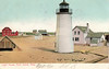 An old postcard view of the Plum Island Light Station showing the Keepers dwelling and the oil house.